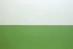 Cement wall painted green and cream color. Stock Image