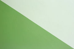 Cement wall painted green and cream color. Royalty Free Stock Image