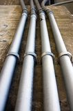 Cement wall , pipes Royalty Free Stock Photos