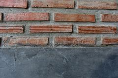 Cement wall with red brick royalty free stock photo