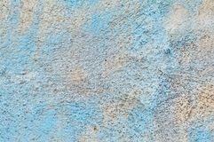 texture of cement wall with remains of blue paint stock photo