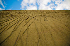 Cement wall scratches blue sky clouds. Concept escape sandy wall lines thin sky piece Royalty Free Stock Images