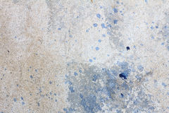 Cement wall with stain of blue oil color, cement texture. Royalty Free Stock Photos