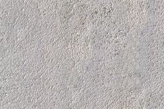 Cement wall texture. Light gray limestone texture for background, seamless, tiling Royalty Free Stock Image