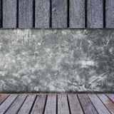 Cement wall with wooden shelves. Stock Photo