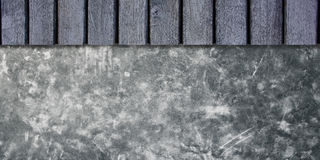 Cement wall with wooden shelves. Royalty Free Stock Images