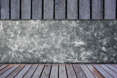 Cement wall with wooden shelves. Royalty Free Stock Photo