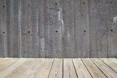 Cement wall and wooden walkway background Royalty Free Stock Images