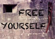 Cement wall with the word Free Yourself royalty free stock photos