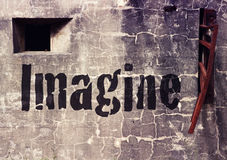 Cement wall with the word Imagine Stock Image