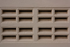Cement walls have openings for ventilation in and out. Royalty Free Stock Photography