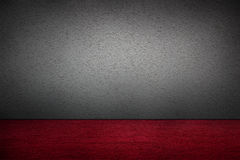 Cement walls and red carpet. Royalty Free Stock Image
