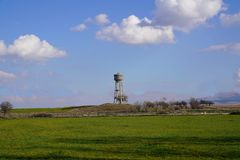 Cement water storage tank in a green grain field Stock Photography
