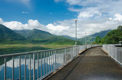 Cement way on top of dam with nature view Stock Photos