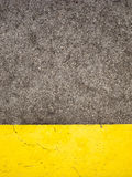 Cement and Yellow Paint. Weathered cement floor background with yellow paint Stock Photos