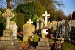 Cementary. Old cemetery in England, the tombs of some very old, even after 200 years, stone, green grass, eternal rest, crosses, angels, monuments, the memory of Stock Photo