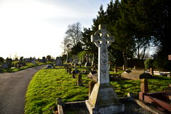 Cementary. Old cemetery in England, the tombs of some very old, even after 200 years, stone, green grass, eternal rest, crosses, angels, monuments, the memory of Royalty Free Stock Photos