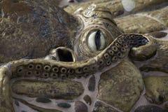 Cementbläckfisk inbäddad i en Planterkant Arkivbilder