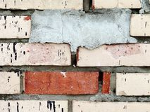 Cemented and Red Bricks. Photo of old and dirty white bricks with one cemented brick - to add your text on it Royalty Free Stock Photo