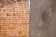 A cemented wall and a brick wall background. Cemented wall brick background copy space cement walls bricks stock image