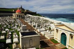 Cementerio Santa Maria Magdalena de Pazzi with Capilla del Cementerio Santa Maria and San Felipe del Morro Fortress on the backgro Royalty Free Stock Images