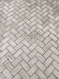 Cementing of rectangular blocks of cement embedded in zigzag. Cementing texture of rectangular cement blocks embedded in a zigzag pattern Stock Photos