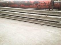 cemento postes y tubo del metal Imágenes de archivo libres de regalías