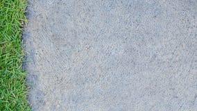 Cementowa podłogowa tuxture ans trawa Obraz Stock