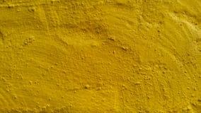 Cementsurfage Kulör conkrete yellow Bakgrund textur royaltyfri foto