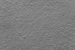 Cementvägg med modeller och sprickor - högkvalitativ textur/bakgrund royaltyfri fotografi
