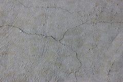 Cementvägg med sprickan Arkivfoton