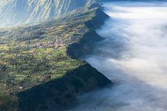 Cemero Lawang village in a morning with sea of mist, Bromo mount Royalty Free Stock Image