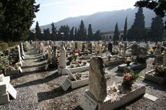 Cemetary. Monumental cemetery of staglieno in Genoa, large field with many tombs lined up on the ground royalty free stock photo