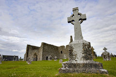 Cemetary and Church in Ireland. Cemetary and Church in Republic of Ireland with Blue Sky and extreme wide angle view Stock Images