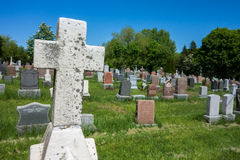Cemetary stone cross Stock Images
