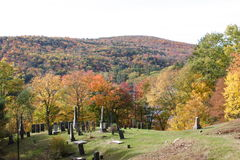 Cemetary on top of a hill in Autumn Royalty Free Stock Photos