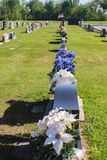 Cemetary in USA with tombstones decorated for Memorial day and U royalty free stock photo