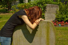 Cemetery. A young woman in a cemetery Royalty Free Stock Photos