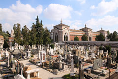 Cemetery. Milan, Italy. Famous landmark - the Monumental Cemetery (Cimitero Monumentale) with Famedio chapel in the background Royalty Free Stock Photography