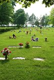 Cemetery. Artificial flowers adorn many graves in this cemetery Royalty Free Stock Photos