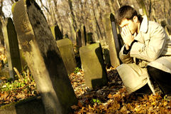 Cemetery. Photo of crying man on the cemetery Royalty Free Stock Photography