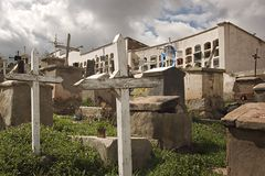 Cemetery. With mausoleum in the background and foreboding sky. Potosi, Bolivia royalty free stock image