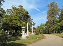 Cemetery. Old historic cemetery with blue sky trees Royalty Free Stock Photos