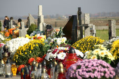 Cemetery. Flowers and candles on cemetery in autumn Royalty Free Stock Photography