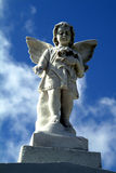 Cemetery angel. On top of large tomb Royalty Free Stock Images