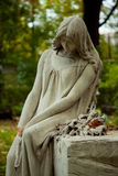 Cemetery angel. Graves on cemetery, angel and vase Royalty Free Stock Photo