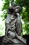 Cemetery angel. Graves on cemetery, angel and vase stock photos