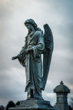 Cemetery Angel. An statue of an angel in a cemetery against a cloudy background Stock Photography