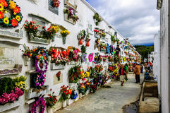 Cemetery, Antigua, Guatemala. San Lázaro Cemetery, Antigua, Guatemala - Nov 2, 2014:  Wreath covered wall of tombs on All Soul's Day in Spanish colonial town of Royalty Free Stock Photography