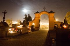 Free Cemetery At Night. Burning Candles On The Graves. Stock Image - 130818541